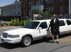 Tours by Towncar owner Jim Currie poses in Kilt and all by his signature limousine.